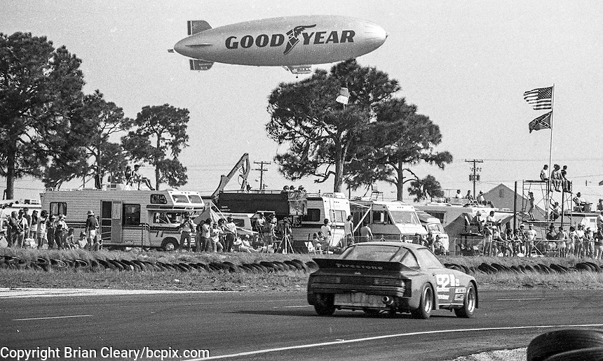 GoodYear Blimp flies above the #92 Mazda RX-7 of  Terry Visger and Lee Mueller (17th place) 12 Hours or Sebring, Sebring International Raceway, Sebring, FL, March 19, 1983.  (Photo by Brian Cleary/bcpix.com)