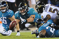 Kelly.Jordan@jacksonville.com -- 10/24/11-- Zach Potter reaches for a ball on the punt by Nick Harris at 2:40 in he 2nd quarter. The Jacksonville Jaguars played against the Baltimore Ravens on EverBank Field in Jacksonville, FL on Monday October 24, 2011.   (The Florida Times-Union, Kelly Jordan)