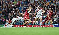 Wales's James Davies evades the tackle of England's Daniel Bibby<br /> <br /> Wales Vs England - men's classification 5th - 6th place match<br /> <br /> Photographer Chris Vaughan/CameraSport<br /> <br /> 20th Commonwealth Games - Day 4 - Sunday 27th July 2014 - Rugby Sevens - Ibrox Stadium - Glasgow - UK<br /> <br /> © CameraSport - 43 Linden Ave. Countesthorpe. Leicester. England. LE8 5PG - Tel: +44 (0) 116 277 4147 - admin@camerasport.com - www.camerasport.com