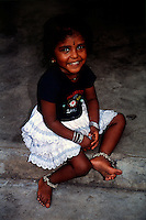 Young Hindu girl smiles for the camera. Melaka - Malaysia.