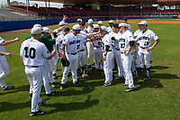 Dartmouth Big Green head coach Bob Whalen (2) meets with his team prior to a game against the Lehigh Mountain Hawks on March 20, 2016 at Chain of Lakes Stadium in Winter Haven, Florida.  Included are Beau Sulser (10), Adam Charnin-Aker (22), Justin Fowler (25), Michael Ketchmark (27), Nate Ostmo (19).  Dartmouth defeated Lehigh 5-4.  (Mike Janes/Four Seam Images)