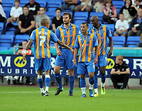Pictured: Shrewsbury Tow players celebrating their equaliser. Tuesday 23 August 2011<br />