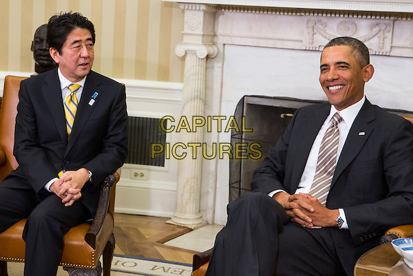 United States President Barack Obama, right, with Prime Minister Shinzo Abe of Japan, left, during a photo-op in the Oval Office of the White House in Washington, D.C. following a bilateral meeting between the two leaders on Friday, February 22, 2013. half length sitting  suit tie 44th President, America, American, Barack Obama, Chief Executive, Commander-in-Chief, Democrat, Democratic, Japan, Japanese, Prime Minister, PM, Oval Office, POTUS, President Obama, U.S., US, USA, United States, White House, diplomacy, diplomat, foreign affairs, foreign policy, global, government, international, international relations, leaders, meeting, national, news, people, political, politicians, politics, presidential.CAP/ADM/CNP/KT.© Kristoffer Tripplaar/CNP/AdMediaAdMedia/Capital Pictures.