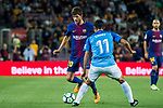 Sergi Roberto Carnicer (l) of FC Barcelona fights for the ball with Chory Castro of Malaga CF during the La Liga 2017-18 match between FC Barcelona and Malaga CF at Camp Nou on 21 October 2017 in Barcelona, Spain. Photo by Vicens Gimenez / Power Sport Images