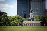 PENNSYLVANIA, Philadelphia, Kids running infront of Independence Hall at Dusk