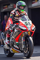 Eugene Laverty (IRL) riding the Aprilia RSV4 1000 Factory (58) of the Aprilia Racing Team leaving the pits for a practise session on day one of round one of the 2013 FIM World Superbike Championship at Phillip Island, Australia.