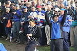 Rory McIlroy drives the crowds wild on the 17th green watched by Padraig harrington and Graeme McDowell as they wait for the Molinari Match on day three sesion threeFourballs and Foursomes matches  on saturday afternoon at the 2010 Ryder Cup at the Celtic Manor twenty ten course, Newport Wales, 3/10/2010.Picture Fran Caffrey/www.golffile.ie.