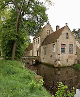 The entrance to this manor house near Bruges is reached by a bridge across the moat