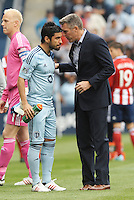 Peter Vermes Head Coach Sporting KC talks with Paulo Nagamura..Sporting Kansas City defeated Chivas USA 4-0 at Sporting Park, Kansas City, Kansas.