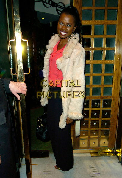 JUNE SARPONG.Spotted at The Ivy restaurant, London, England,.August 31st 2007..full length beige cream fur coat jacket pink coral top shirt black trousers.CAP/CAN.©Can Nguyen/Capital Pictures
