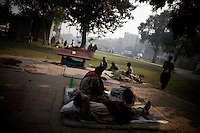 Homeless heroin addicts lay in a park in  Lahore's Hira Mandi neighborhood, Pakistan on Monday December 01 2008.///..While Bangladesh, India, Nepal and Maldives all suffer from drug consumption, Pakistan is the worst victim of the drug trade in South Asia. Today, the country has the largest heroin consumer market in the south-west Asia region..The drug addicts resort to crime for generating income for the purchase of narcotics. The situation is becoming serious due to the number of heroin addicts in the country. An alarming rate of increase of 100,000 addicts per year is highly dangerous to society. The drug addicts are affecting nearly 20 million dependents and family members with psychological, social, and economic repercussions.