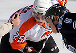 OMAHA, NE - FEBRUARY 9:  Tyler Hynes #25 from Omaha and Tommy Schutt #8 from Lincoln wait for the puck to drop in the first period at the Battle on Ice Saturday at TD Ameritrade in Omaha, NE. (Photo by Dave Eggen/Inertia)