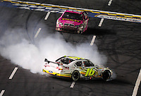 Oct. 17, 2009; Concord, NC, USA; NASCAR Sprint Cup Series driver Greg Biffle (16) spins during the NASCAR Banking 500 at Lowes Motor Speedway. Mandatory Credit: Mark J. Rebilas-