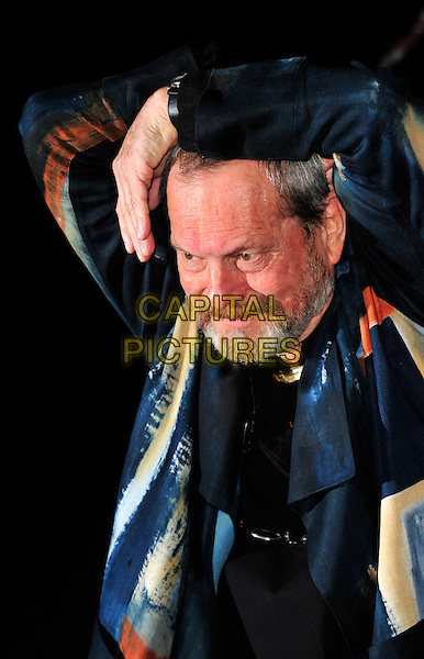 "TERRY GILLIAM.The UK Premiere of ""The Imaginarium Of Doctor Parnassus"" at the Empire Leicester Square, London, England..October 6th 2009.half length hands arms shiny blue grey gray black print watercolour director shirt  beard facial hair .CAP/CJ.©Chris Joseph/Capital Pictures."
