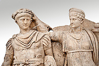 Roman releif sculpture of Aphrodite is crowned by Andreia from Aphrodisias, Turkey, Images of Roman art bas releifs. Buy as stock or photo art prints.  The drapped goddess figure is thought to be Aphrodite, whilst the female bare breasted warrior in amazonian dress is Roma or Andreia [ Bravery ].