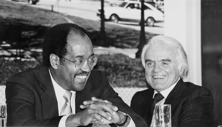 Rep. William H. Gray, D-Pa. with Jack Valenti in April, 1988. (Photo by CQ Roll Call)