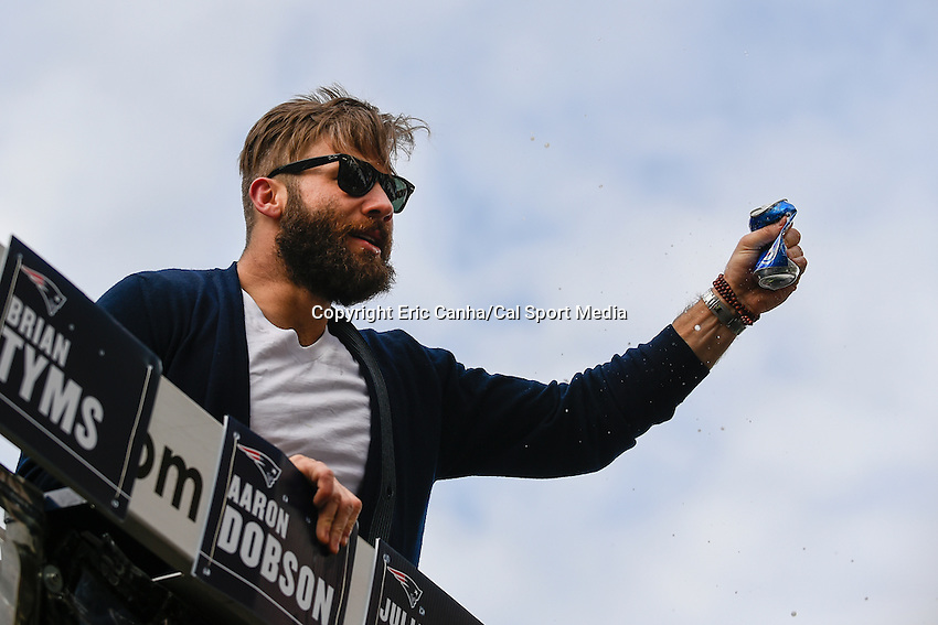 February 4, 2015 - Boston, Massachusetts, U.S. - New England Patriots wide receiver Julian Edelman (11) crashes a beer can during a parade held in Boston to celebrate the team's victory over the Seattle Seahawks in Super Bowl XLIX. Eric Canha/CSM