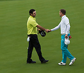 15.10.2014. The London Golf Club, Ash, England. The Volvo World Match Play Golf Championship.  Day 1 group stage matches.  Patrick Reed [USA] congratulates Jonas Blixt [SWE] on his 2 and 1 win on the seventeenth.
