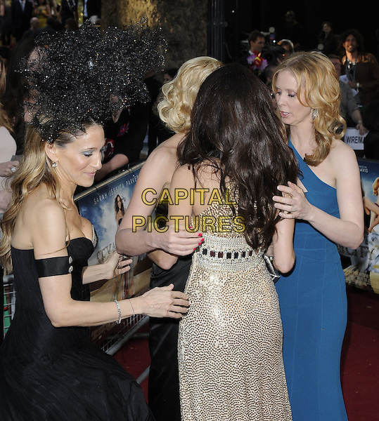 SARAH JESSICA PARKER, KRISTIN DAVIS, KIM CATTRALL & CYNTHIA NIXON .Arrivals to the 'Sex And The City 2' European Premiere at the Odeon, Leicester Square, London .May 27th, 2010.full length length black strapless Alexander McQueen dress armband arm band Philip Treacy hat head piece gold sequined sequin blue teal one shoulder straps gem jewel encrusted embellished metallic sjp cast back behind rear profile .CAP/CAN.©Can Nguyen/Capital Pictures.