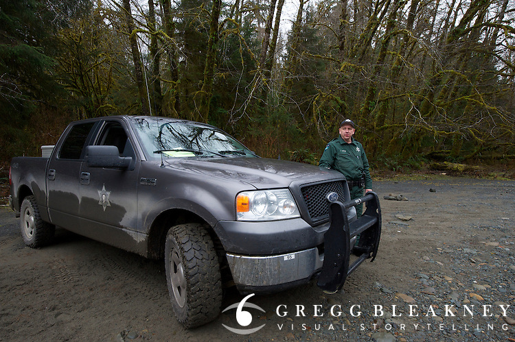 DNR officer Jared Eison on patrol in the Queets Valley. Olympic Peninsula, WA State