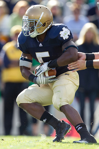 Notre Dame tailback Armando Allen Jr. (#5) takes handoff in game action during NCAA football game between the Notre Dame Fighting Irish and the Purdue Boilermakers.  Notre Dame defeated Purdue 23-12 in game at Notre Dame Stadium in South Bend, Indiana.