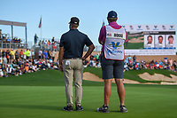 Ryan Moore (USA) and his caddie look over their birdie attempt on 18 during day 4 of the Valero Texas Open, at the TPC San Antonio Oaks Course, San Antonio, Texas, USA. 4/7/2019.<br /> Picture: Golffile | Ken Murray<br /> <br /> <br /> All photo usage must carry mandatory copyright credit (© Golffile | Ken Murray)
