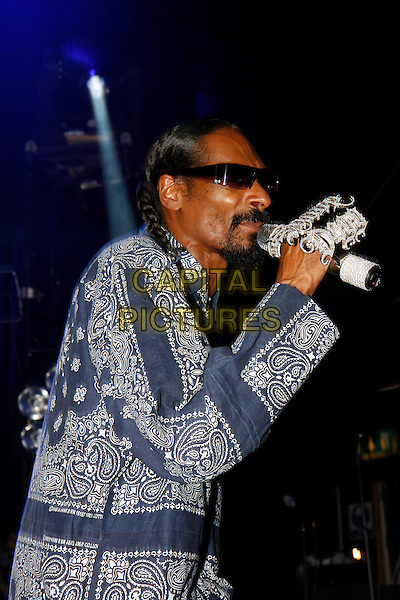 SNOOP DOGG (Cordozar Calvin Broadus).Performing live at the Shepherd's Bush Empire, London, England. .July 9th, 2010.stage concert live gig performance music half length blue grey gray white top sunglasses shades singing microphone pattern jewel jewellery diamonds bling profile .CAP/MAR.© Martin Harris/Capital Pictures.