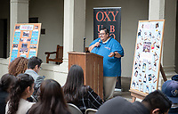 """Jesus Maldonado '00, Director of Upward Bound.<br /> Upward Bound hosts their annual """"End of the Year"""" celebration with participants and their families on May 12, 2018 in the courtyard of Booth Hall. Jimmy Gomez, U.S. Representative for California's 34th congressional district, was the featured speaker at the event.<br /> Upward Bound was established at Occidental College in 1966 and has since served over 2000 first generation, low income students in the Los Angeles region.<br /> (Photo by Marc Campos, Occidental College Photographer)"""