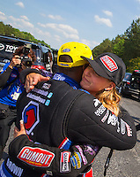 May 17, 2015; Commerce, GA, USA; Top fuel runner-up, Leah Pritchett congratulates NHRA top fuel driver Antron Brown after he wins the Southern Nationals at Atlanta Dragway. Mandatory Credit: Mark J. Rebilas-USA TODAY Sports