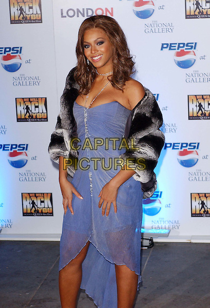 BEYONCE KNOWLES.launch of new Pepsi TV advert..National Gallery, London.26 January 2004.blue strapless floaty dress, fur coat.www.capitalpictures.com.sales@capitalpictures.com.© Capital Pictures.