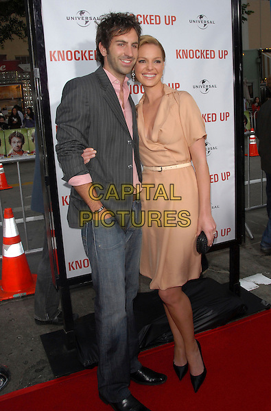"""JOSH KELLY & KATHERINE HEIGL .The Universal Pictures' World Premiere of """"Knocked Up"""" held at The Mann's Village Theatre in Westwood, California, USA..May 21th, 2007.full length grey gray suit jacket beige wrap dress black clutch purse pinstripe couple jeans denim hand in pocket shoes .CAP/DVS.©Debbie VanStory/Capital Pictures"""