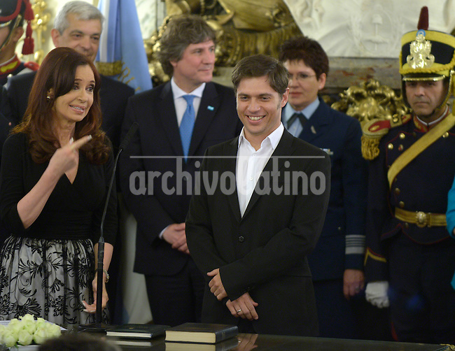 Argentine President Cristina Fernandez de Kirchner  is greated by a crowd when returned to work after undergoing brain surger that left her 6 weeks out of the public eye in Buenos Aires presidential Palace. At her returns to the Pink HOuse, swears Finance Minister Axel Kicilof