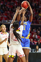 College Park, MD - March 25, 2019: UCLA Bruins forward Michaela Onyenwere (21) shoots over Maryland Terrapins guard Kaila Charles (5) during game between UCLA and Maryland at  Xfinity Center in College Park, MD.  (Photo by Elliott Brown/Media Images International)