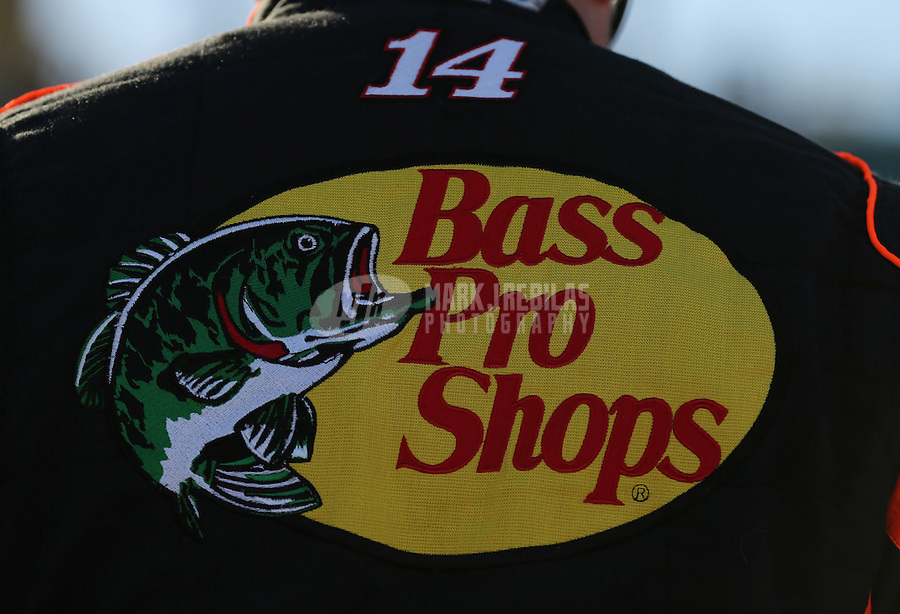 Mar. 1, 2013; Avondale, AZ, USA; Detailed view of the Bass Pro Shops logo on the fire suit of NASCAR Sprint Cup Series driver Tony Stewart during qualifying for the Subway Fresh Fit 500 at Phoenix International Raceway. Mandatory Credit: Mark J. Rebilas-
