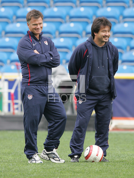 MAR 15, 2006: Faro, Portugal:  USWNT head coach Greg Ryan and assistant coach Bret Hall talk before the beginning of the game against Germany at the Algarve Cup Finals in Faro, Portugal.