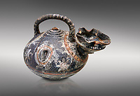 "Minoan Kamares Ware beak spouted  ""teapot"" polychrome decorations, Phaistos 1800-1650 BC; Heraklion Archaeological  Museum, grey background.<br /> <br /> This style of pottery is named afetr Kamares cave where this style of pottery was first found"