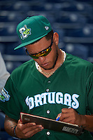 Daytona Tortugas relief pitcher Ismael Guillon (35) signs autographs before a game against the Clearwater Threshers on April 20, 2016 at Bright House Field in Clearwater, Florida.  Clearwater defeated Daytona 4-2.  (Mike Janes/Four Seam Images)