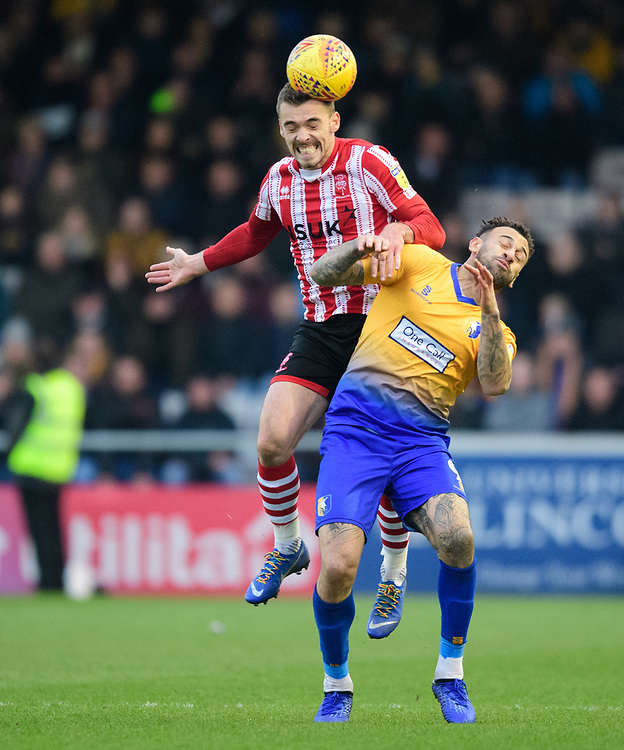 Lincoln City's Harry Toffolo vies for possession with Mansfield Town's Craig Davies<br /> <br /> Photographer Chris Vaughan/CameraSport<br /> <br /> The EFL Sky Bet League Two - Lincoln City v Mansfield Town - Saturday 24th November 2018 - Sincil Bank - Lincoln<br /> <br /> World Copyright © 2018 CameraSport. All rights reserved. 43 Linden Ave. Countesthorpe. Leicester. England. LE8 5PG - Tel: +44 (0) 116 277 4147 - admin@camerasport.com - www.camerasport.com
