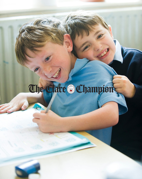Patrick O Connell with his friend Darragh Shearer in class at Kildysart NS. Photograph by John Kelly.