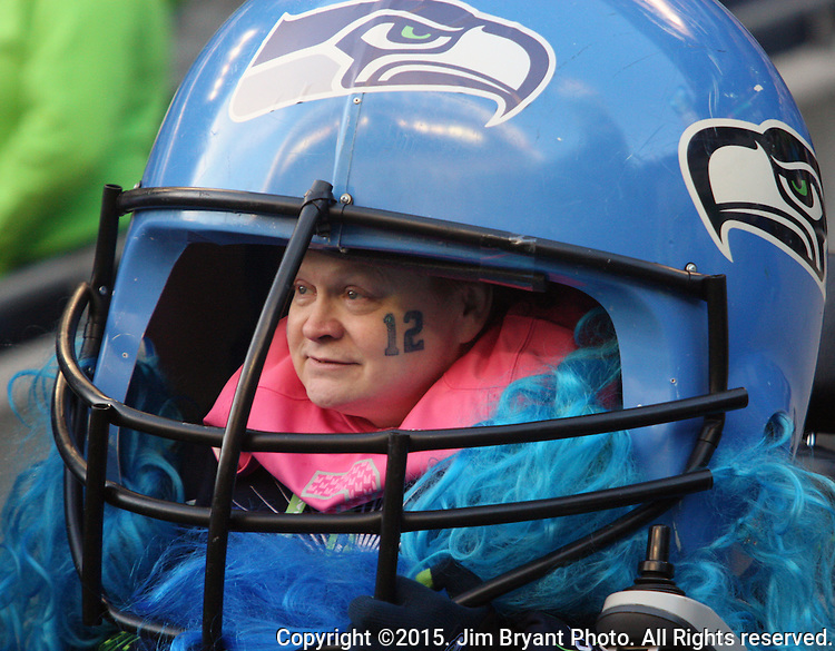 A Seattle Seahawks fan wears an over sized helmet while watching the game against the San Francisco 49ers at CenturyLink Field in Seattle, Washington on November 22, 2015.  The Seahawks beat the 49ers 29-13.   ©2015. Jim Bryant Photo. All RIghts Reserved.