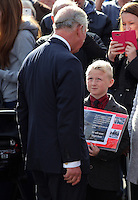 Pictured: Prince Charles speaks to a young boy with an album with pictures from the time at the Memorial Garden in Aberfan Friday 21 October 2016<br /> Re: Wales has fallen silent as the country remembered the Aberfan disaster 50 years ago.<br /> On 21 October 1966, a mountain of coal waste slid down into a school and houses in the Welsh village, killing 144 people, including 116 children.<br /> A day of events to commemorate the disaster included a service at Aberfan Cemetery at 9:15am on Friday.<br /> Prince Charles is visiting Aberfan memorial garden before unveiling a plaque in memory of the victims.<br /> He will also attend a reception with the families of some of those who lost their lives, before signing a book of remembrance.