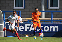 Daniljo Doekhl (Ajax) of Holland under pressure from Lukas Nmecha (Manchester City) of England U19 during the International match between England U19 and Netherlands U19 at New Bucks Head, Telford, England on 1 September 2016. Photo by Andy Rowland.