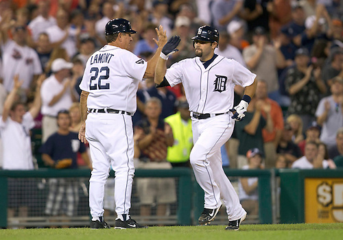August 03, 2011:  Detroit Tigers catcher Alex Avila (#13) high fives third base coach Gene Lamont (#22) after hitting sixth inning home run during MLB game action between the Texas Rangers and the Detroit Tigers at Comerica Park in Detroit, Michigan.  The Tigers defeated the Rangers 5-4.