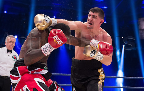 27.02.2016. Halle, Germany.  Marco Huck (R, Germany) and Ola Afolabi (Great Britain) fight during the cruiserweight boxing match at the IBO World Championships in Halle, Germany, 27 February 2016. Marco Huck won in the 10th round.
