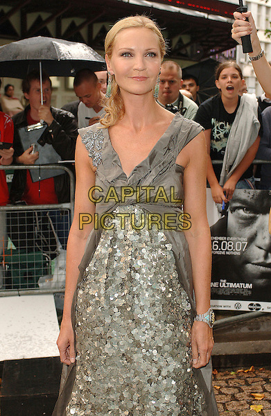 "JOAN ALLEN.attending the UK premiere of the third chapter in the Jason Bourne saga ""The Bourne Ultimatum"",.Odeon Leicester Square, London,15th August 2007..half length Vera Wang gown dress silver grey beaded bracelet.CAP/ BEL.©Tom Belcher/Capital Pictures."