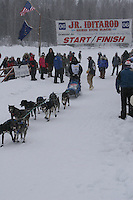 Rohn Buser  leaves the start line of the 2006 Jr. Iditarod race from Willow Lake, Alaska   ..Photo by Ben Schultz