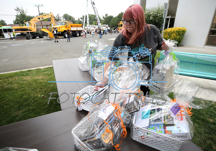 Library assistant Ashley McGuire sets up prizes during the Touch-a-Truck event at the Carson City Library in Carson City, Nev., on Saturday, Aug. 5, 2017. <br /> Photo by Cathleen Allison/Nevada Photo Source