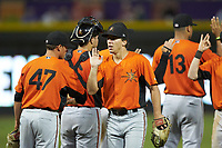 T.J. Nichting (17) of the Frederick Keys high fives his teammates after their win over the Winston-Salem Dash at BB&T Ballpark on July 26, 2018 in Winston-Salem, North Carolina. The Keys defeated the Dash 6-1. (Brian Westerholt/Four Seam Images)