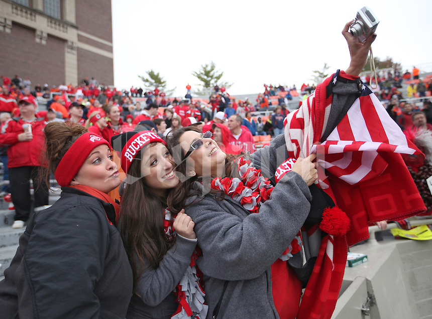 Ohio State University football fans Allison Zoltanski, Nina Zoltanski and Samantha Zoltanski pose for their own photo in the stands filled with Buckeye fans at Memorial Stadium in Champaign, Illinois on November 16, 2013.  (Chris Russell/Dispatch Photo)