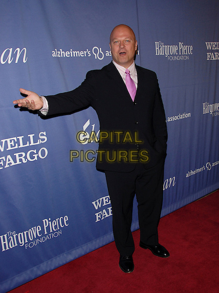 "MICHAEL CHIKLIS.The 15th Annual ""A Night at Sardi's"" Fundraiser and Awards held at The Beverly Hilton Hotel in Beverly Hills, California, USA..March 7th, 2007.full length black suit hand arm .CAP/DVS.©Debbie VanStory/Capital Pictures"